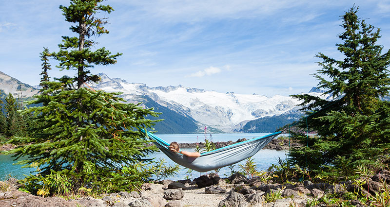 woman in camping hammock in Garibaldi Lakes, BC