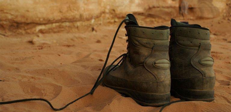 hiking boots on sand