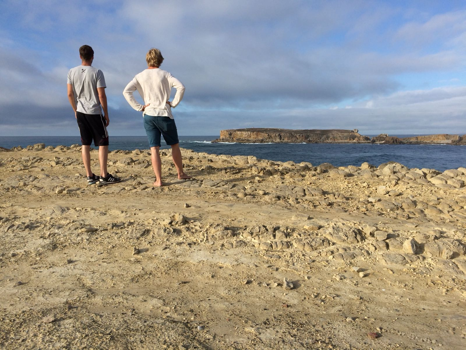 Friends of the author checking waves in Peniche