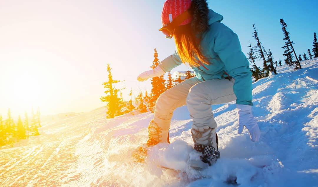 woman snowboarding