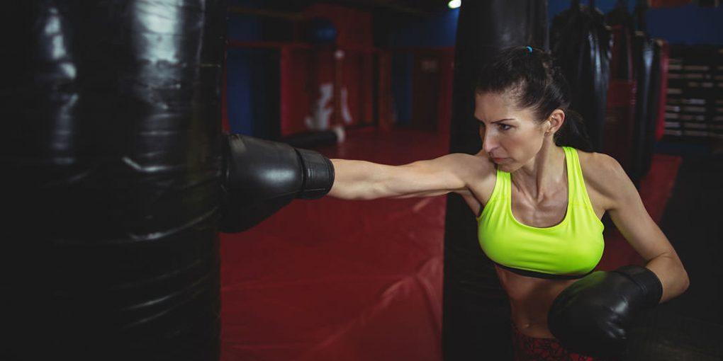 woman at punching bag