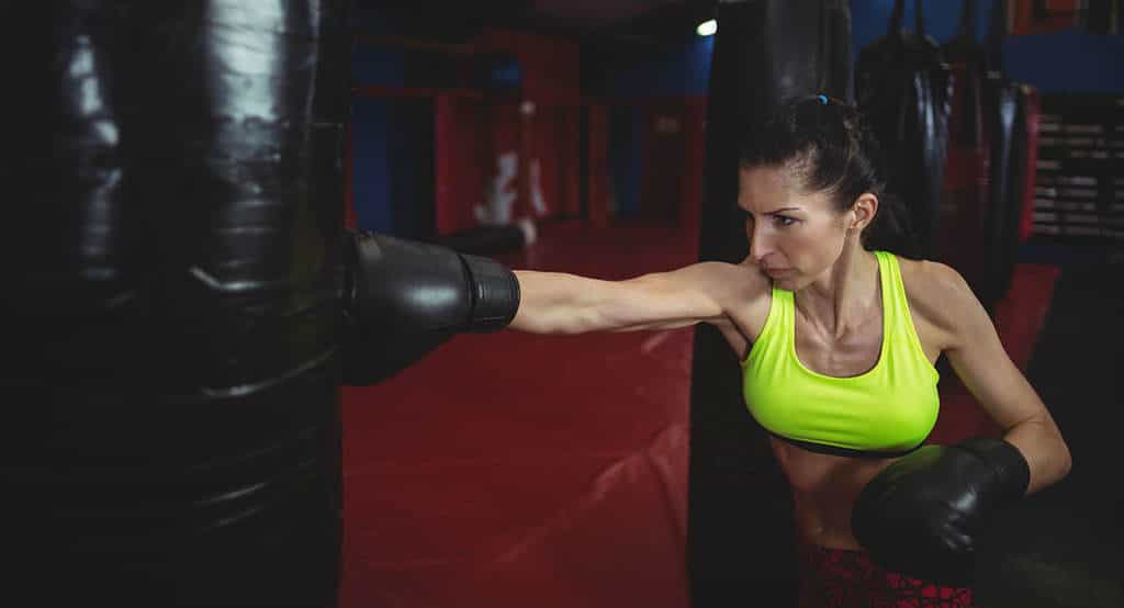 woman at punching bag