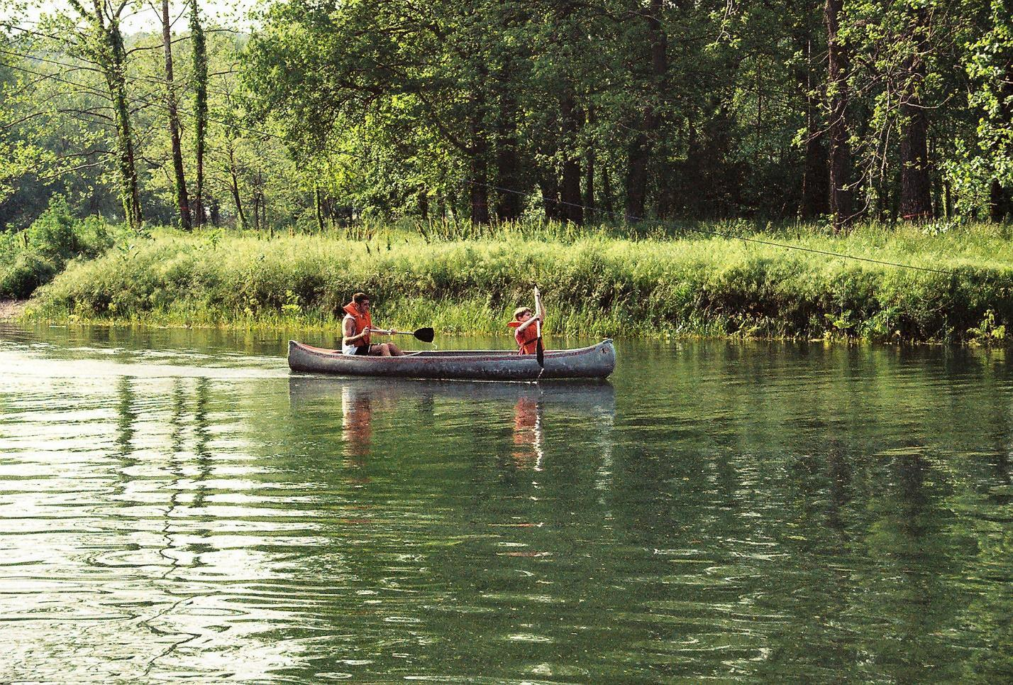 family in canoes