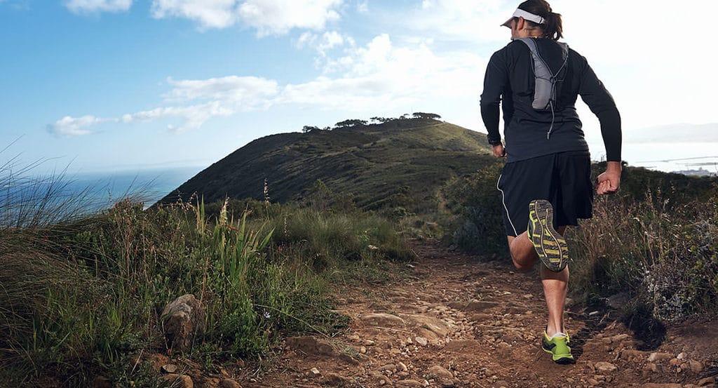 trail runner on mountain trail