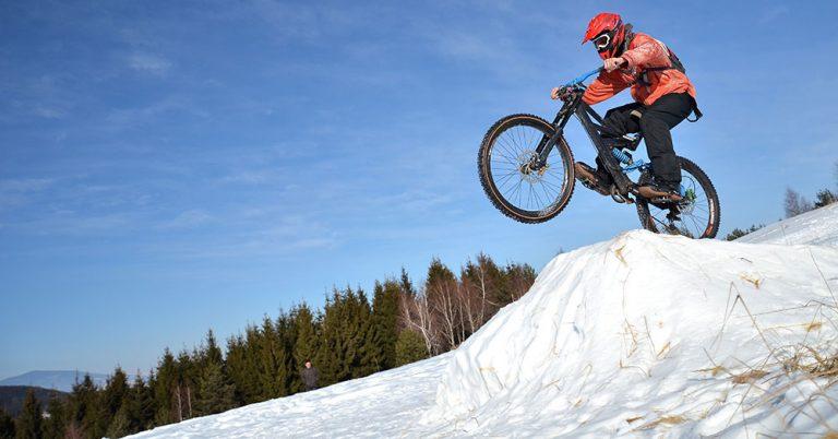 downhill mountain biking in snow
