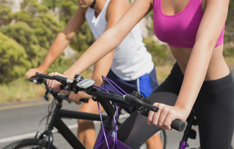 athletic couple cycling