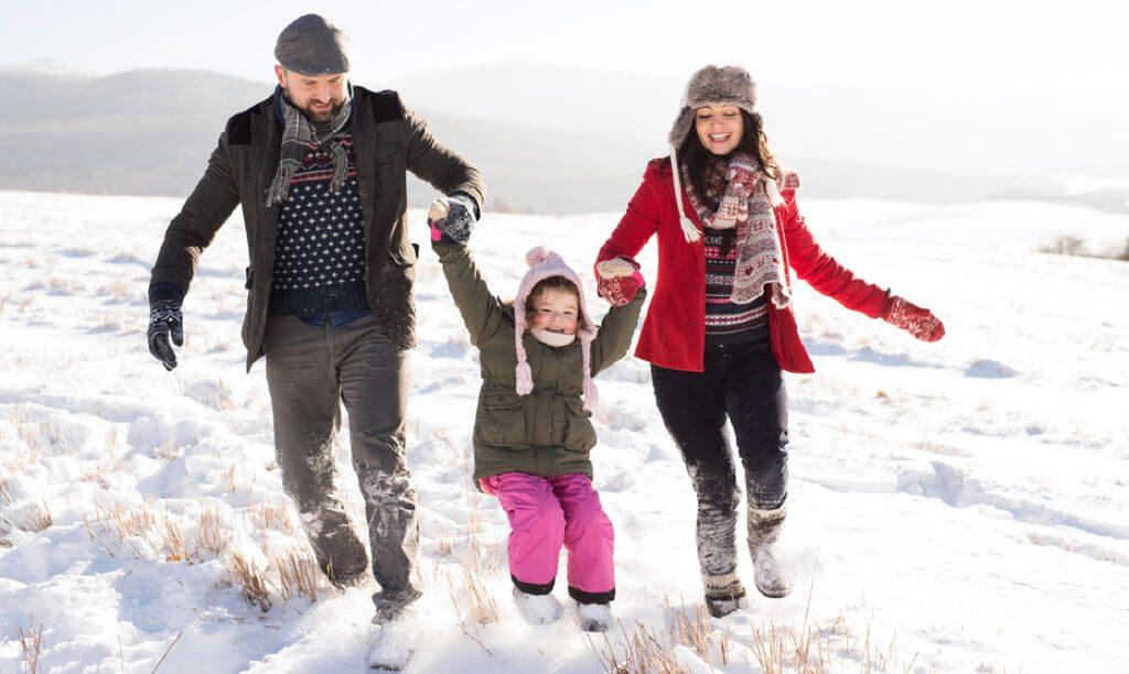 family in snow