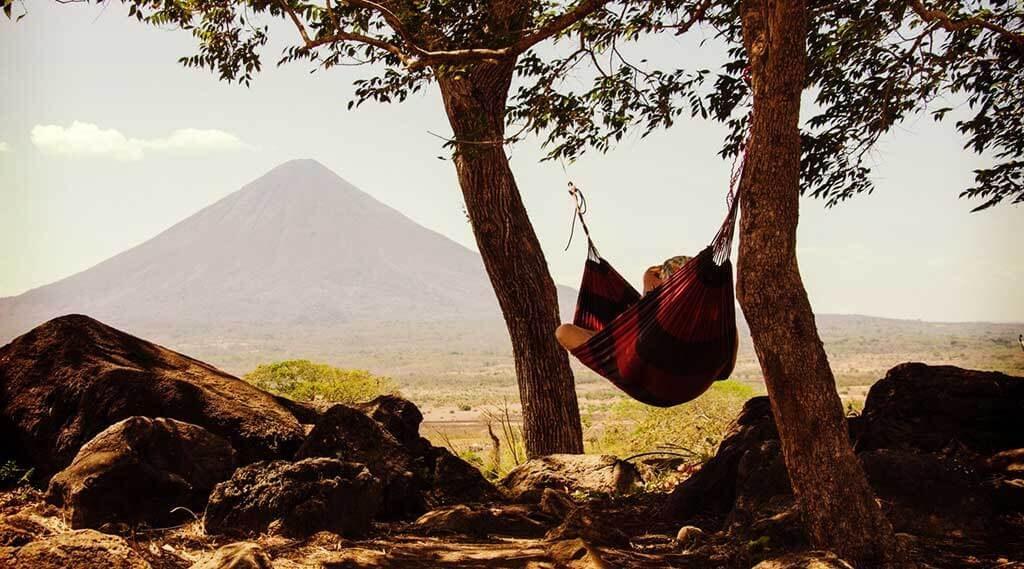 person hammock camping