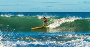 guy paddleboard surfing