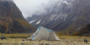 waterproof tent in foggy mountain valley