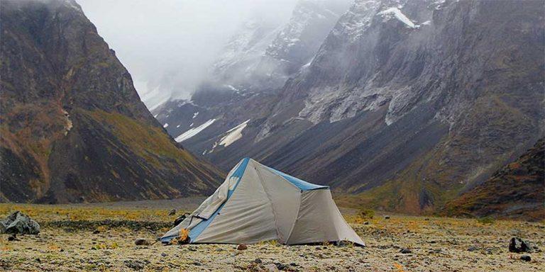 waterproof tent in foggy mountain valley