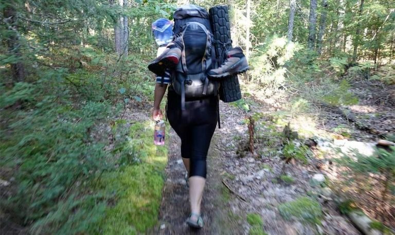 woman backpacking in national park