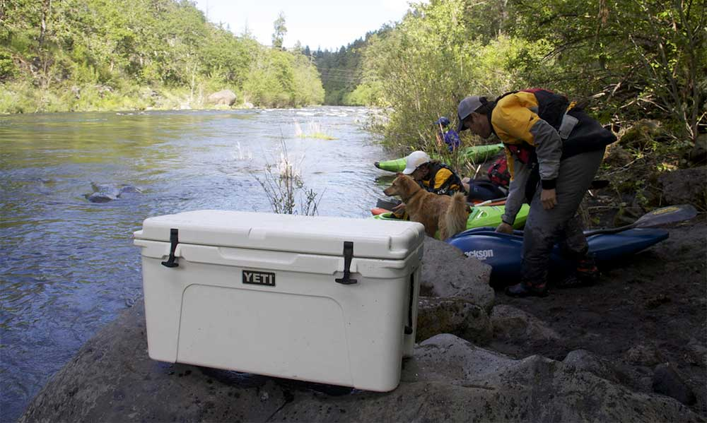 yeti cooler on river bank
