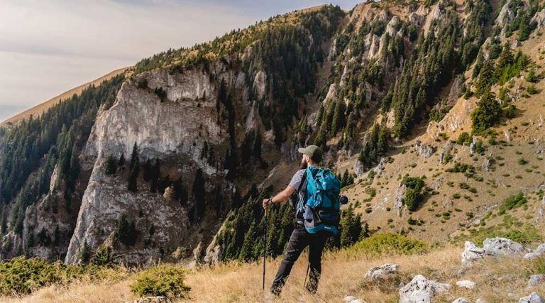guy hiking with poles