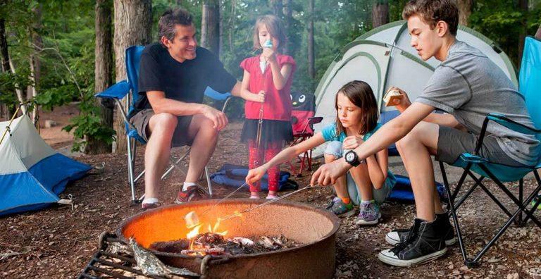 family camping making smores