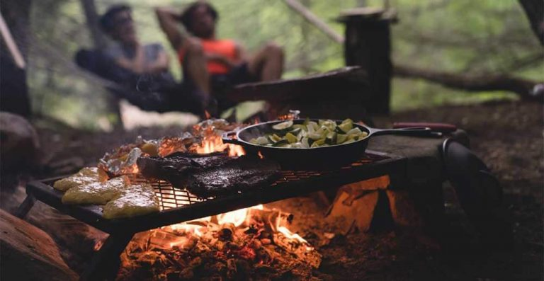 food cooking over campfire