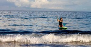 woman kneeling on SUP