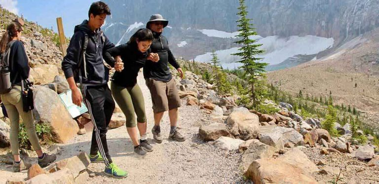 hiker getting helped