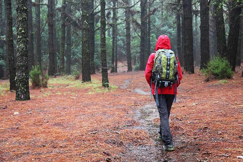 woman hiking in rain