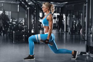 woman doing lunge with weights