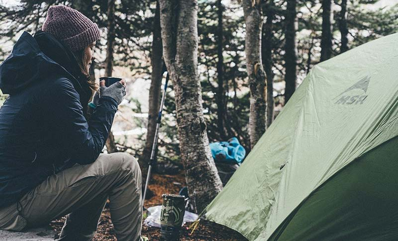 woman camping with tent