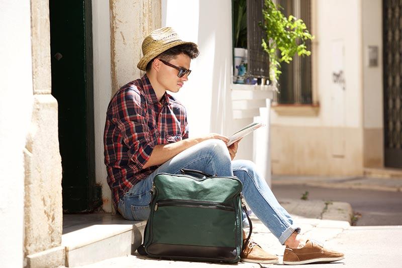 guy reading on steps
