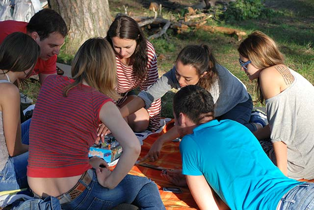 teens playing board games outside