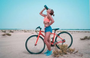 woman cycling beach