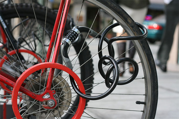 bike with cable lock through wheel spokes