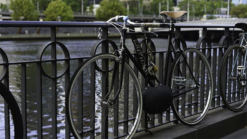 bike locked to bridge