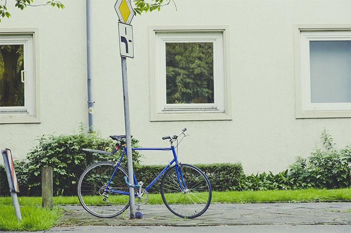 bike locked to sign