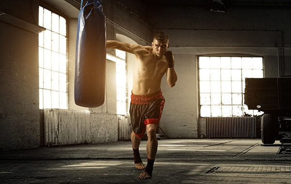 guy boxing heavy bag