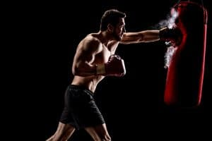 guy hitting heavy bag