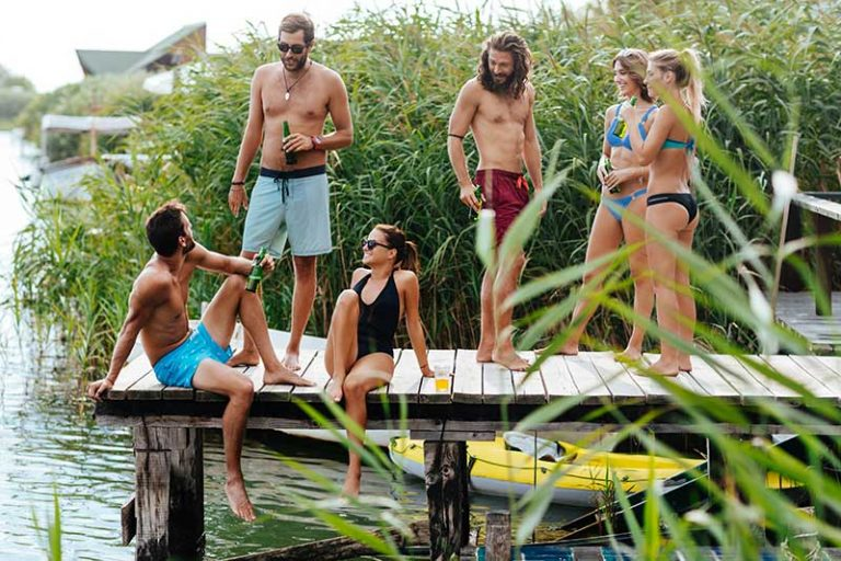 people drinking on the dock