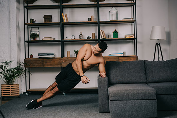 using the sofa for side plank exercise