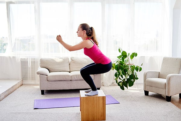 woman using home furniture for workouts