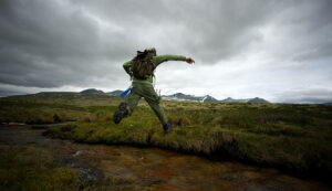 hiker jumping water