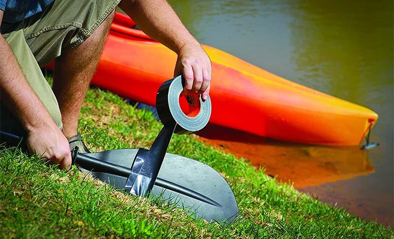 repairing paddle with gorilla tape