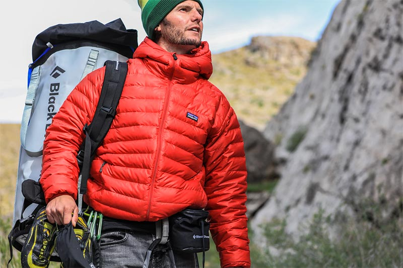 climber wearing patagonia down sweater jacket