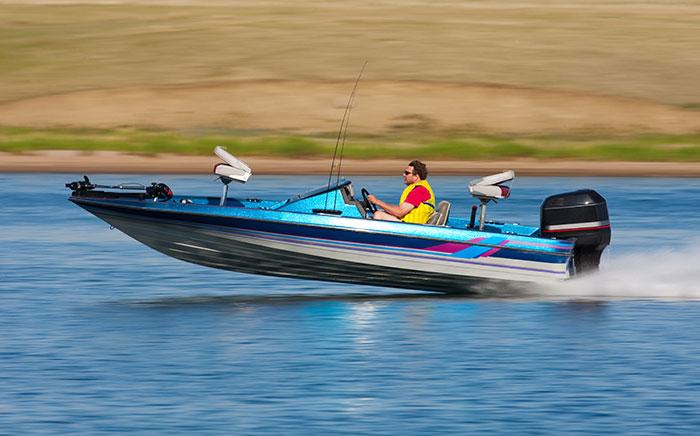 guy in speed boat