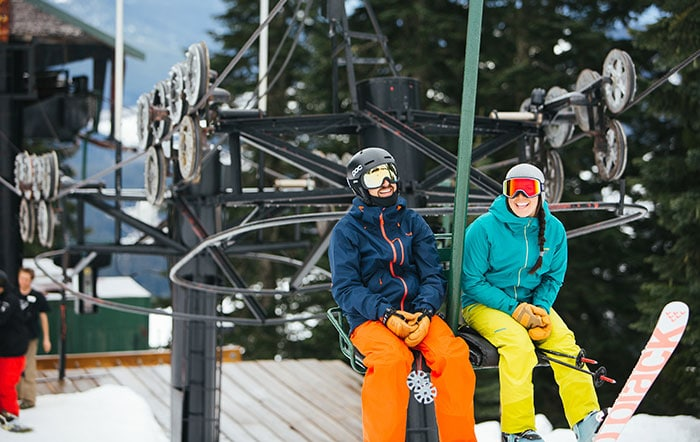 skiers laughing on chairlift