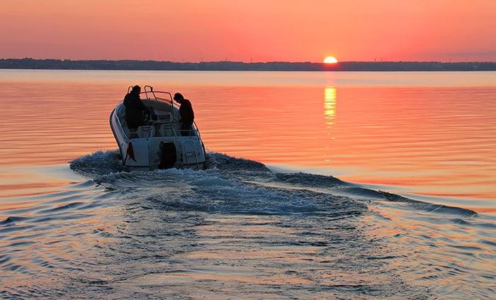 speedboat at sunset