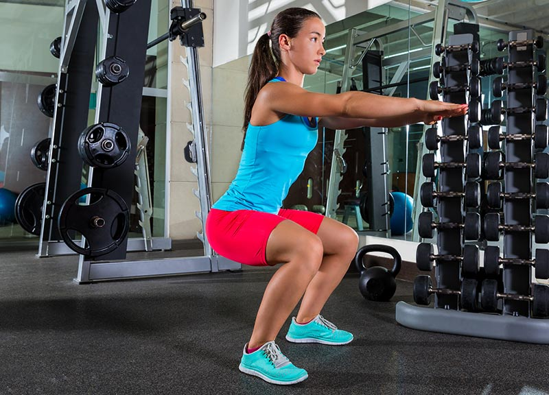 woman doing air squats
