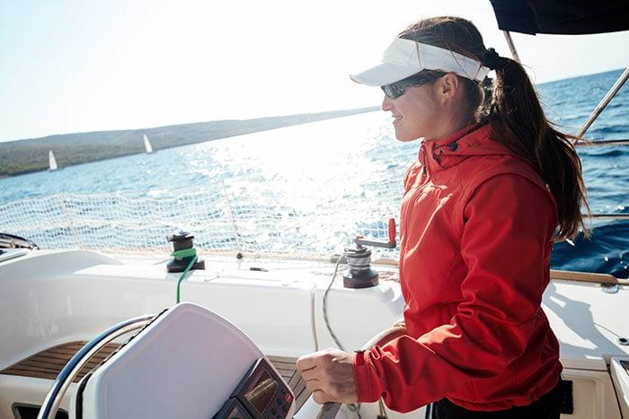 woman driving sailboat
