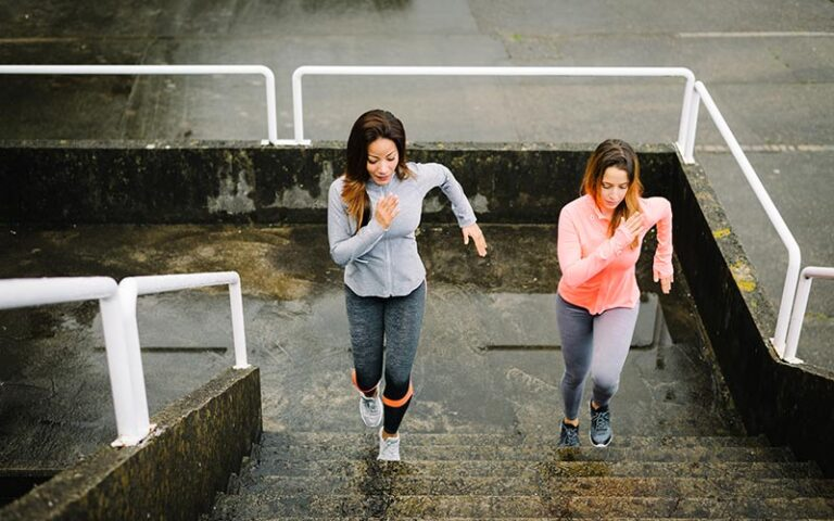 women stair climbing for HIIT