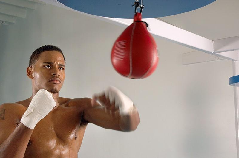 boxer hitting speed bag