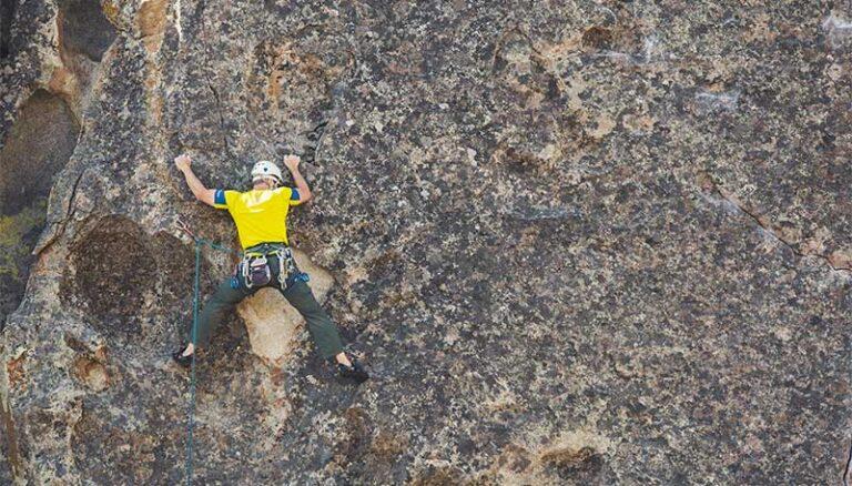 guy rock climbing