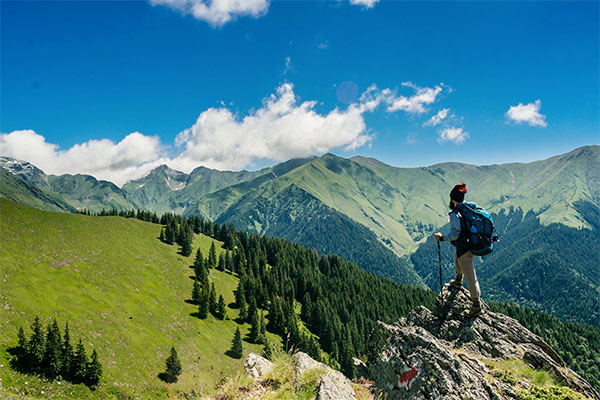 guy hiking green mountains