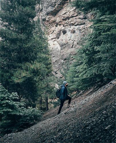 guy hiking steep trail