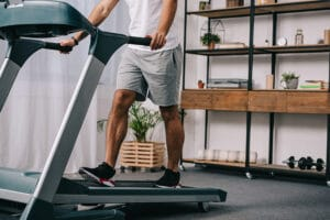 man on treadmill in apartment